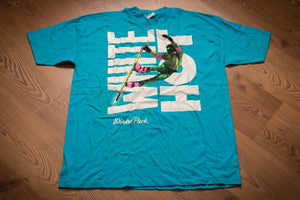"Vintage 80s bright teal t-shirt with neon colored snowboarder graphic over the words ""White Hot"""