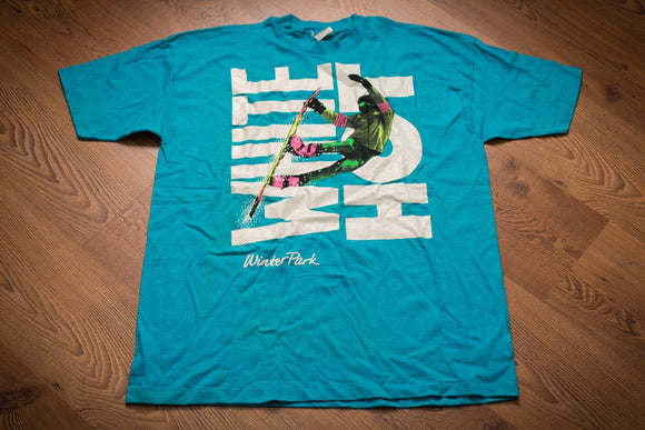 Vintage 80s bright teal t-shirt with neon colored snowboarder graphic over the words