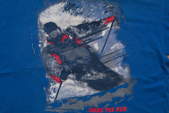 vintage 90s blue t-shirt with graphic of man skiing in snow
