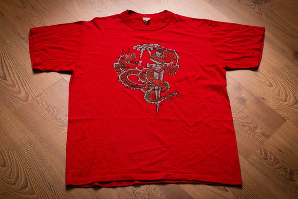 vintage 80s red t-shirt with graphic of dragon and snake wrapping around a dagger