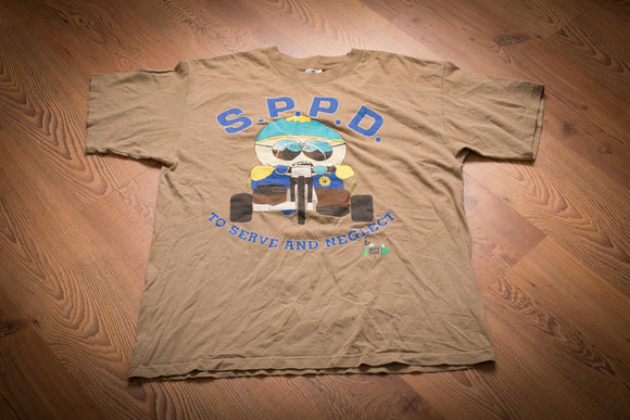 Vintage 90s brown t-shirt with South Park's Cartman in police uniform on a tricycle and text reading