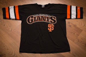 Vintage 1980s black t-shirt with San Francisco Giants name and logo and orange and white stripes on the sleeves