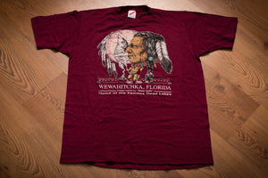 vintage 80s burgundy t-shirt with graphics of native american chief, wolf and peace pipe. souvenir from wewahitchka florida