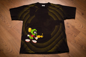 Vintage 90s black t-shirt with Marvin the Martian holding his ray gun on a background of the Looney Tunes rings