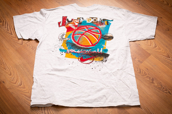 vintage 90s white t-shirt with graffiti style graphics of nike logo, basketball, and just do it text