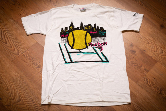vintage 80s white t-shirt with neon graphics of reebok, us open tennis and new york city