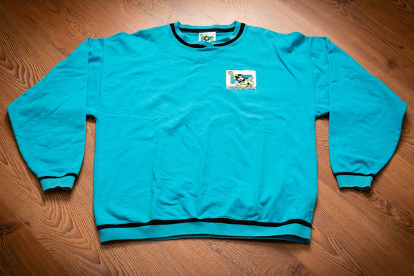 Vintage 80s to 90s bright teal long sleeve t-shirt with Mickey Mouse playing tennis patch and Prince tennis logo