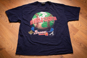vintage 90s blue t-shirt with text and graphics celebrating the atlanta braves as 1995 mlb world champions