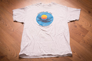 vintage 90s t-shirt with science on the suncoast logo