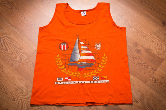 vintage 80s to 90s orange tank top with sailboat and nautical flag graphics and puerto rico text