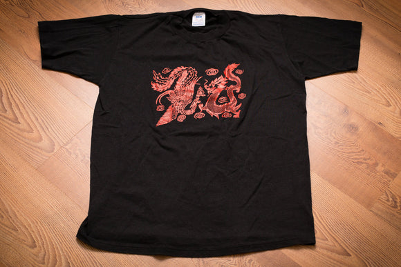 vintage 90s black t-shirt with red graphic of a dragon fighting a phoenix
