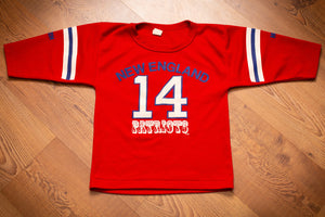 vintage 80s red jersey with new england patriots text and number 14 steve grogan with stripes on sleeves