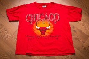 vintage 90s red t-shirt with chicago bulls logo and text