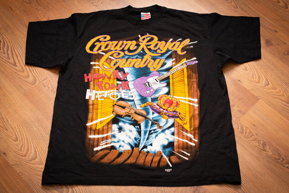 Vintage 90s black t-shirt from the 1994 Crown Royal Honky Tonk Heroes tour with a graphic of guitar, violin and tornado flying through saloon doors