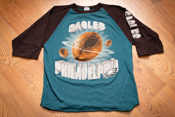 vintage 90s teal and black t-shirt with football graphics and philadelphia eagles text