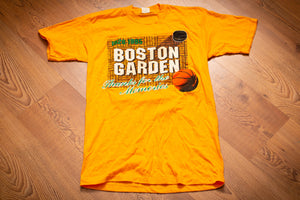 Vintage 90s yellow t-shirt with graphics and text celebrating the Boston Garden from 1928-1995