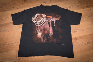 vintage 90s black t-shirt with rodeo saddle and cowboy gear graphic