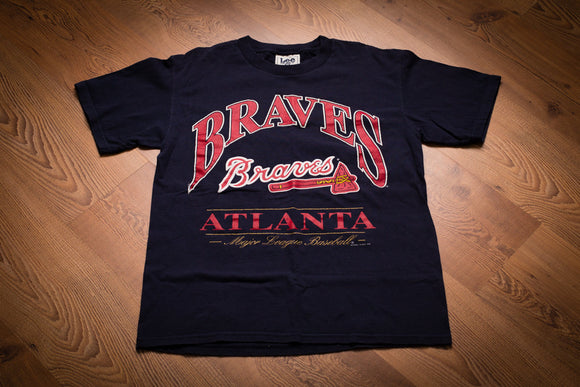 vintage 90s blue t-shirt with atlanta braves text and tomahawk logo