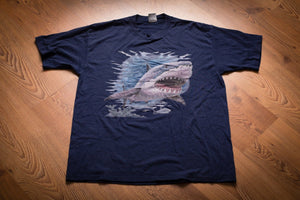 vintage 80s to 90s blue t-shirt with vicious shark graphic