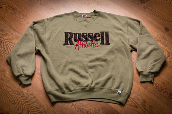 Vintage 80s to 90s olive green sweatshirt with spellout Russell Athletic text