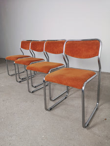 CHROME AND VELVET ORANGE CHAIRS