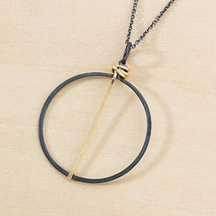 black circle necklace with gold bar