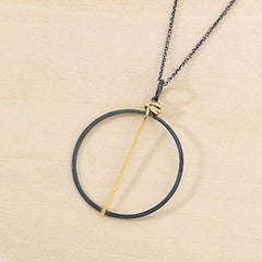 black circle necklace with gold bar handmade in Nashville