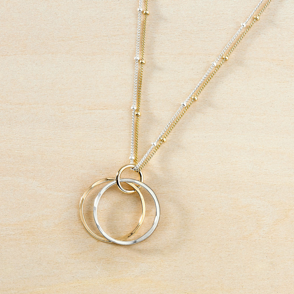 Simple beaded silver and gold necklace with circles