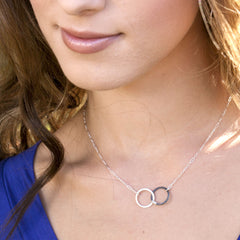 Linked circle small pendant necklace in sterling silver