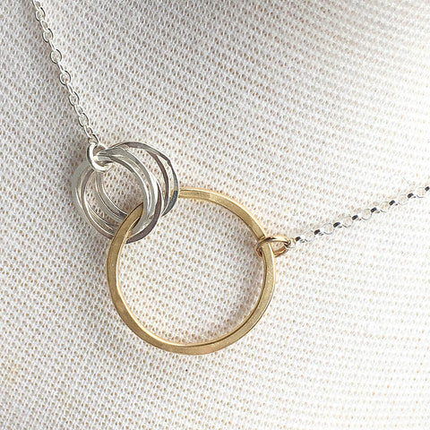 love necklace with four small circles
