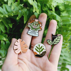 enamel pins by worthwhile paper cat in leaves