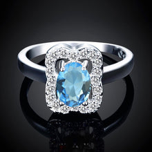 Load image into Gallery viewer, Blue Topaz Emerald Cut Pav'e Ring