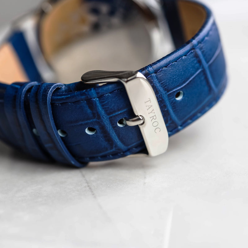 A two dial chronograph timepiece, all strapped up with genuine Italian leather in blue.  Back view.
