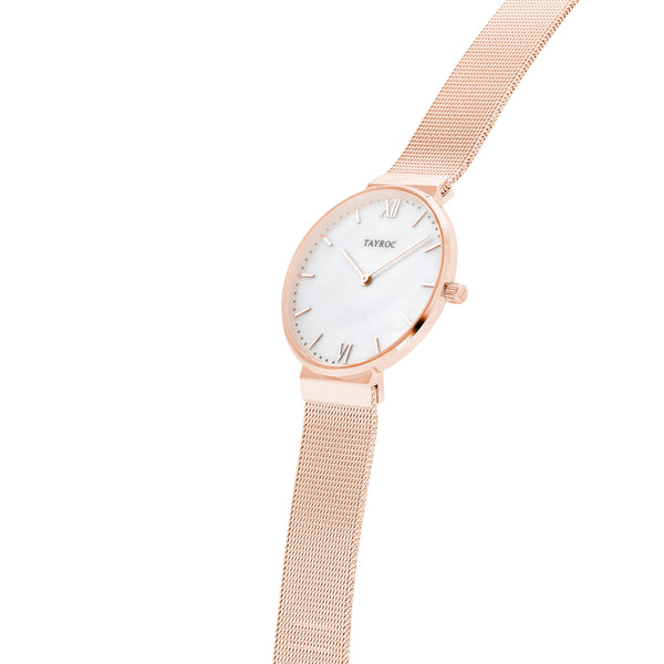 Azure by Tayroc. A carefully crafted rose gold and white watch. Side View.