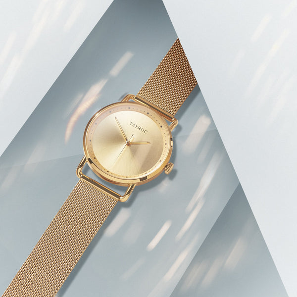 All gold watch with analogue, minimalist styling. Belgravia favours the bold with it's strong colouring and sleek design