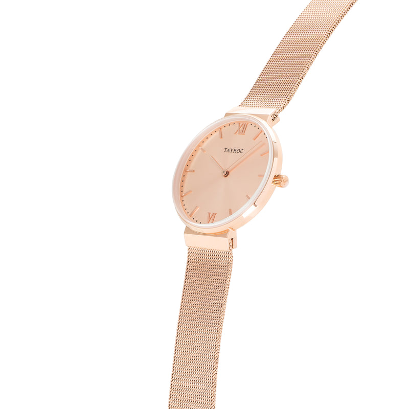 An all rose gold watch for women featuring mesh strap, analogue design and all rose gold materials. Side Shot.