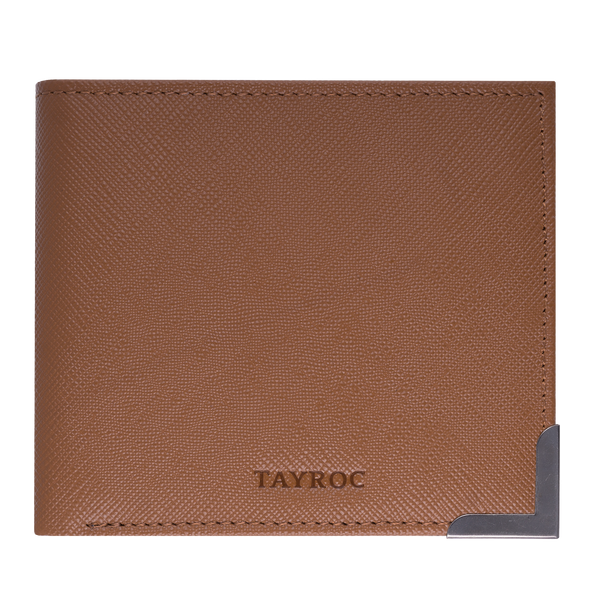 Clyde by Tayroc is a textured leather, mens bifold wallet in tan, featuring a stylish steel bracket feature corner, embossed Tayroc logo and edge stitching. Front view.