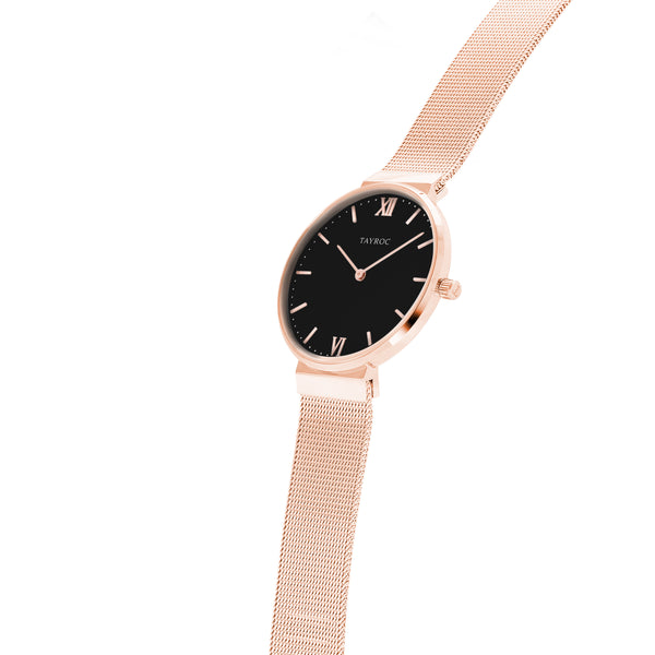 Esen is a black and rose gold watch, complete with fine woven mesh band design and beautifully contrasting black face to the rose gold features. Side View.