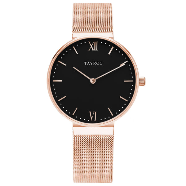 Esen is a black and rose gold watch, complete with fine woven mesh band design and beautifully contrasting black face to the rose gold features. Front View.
