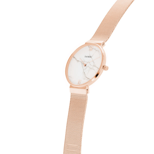 Reva. Classy, couture. A rose gold and white marble watch. Side View.