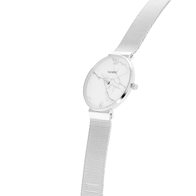 Skye. A silver and white marble watch, Side View.