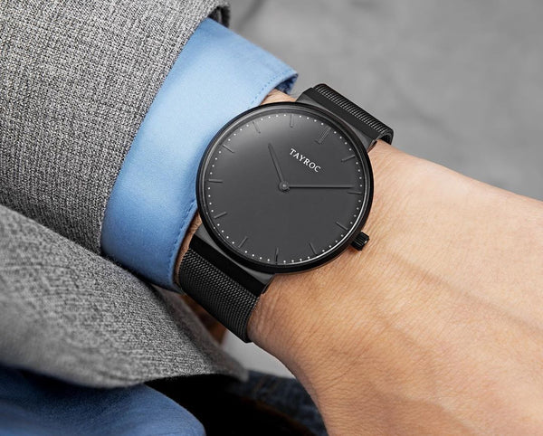 A minimalist black watch from the Signature collection at Tayroc being worn by a model