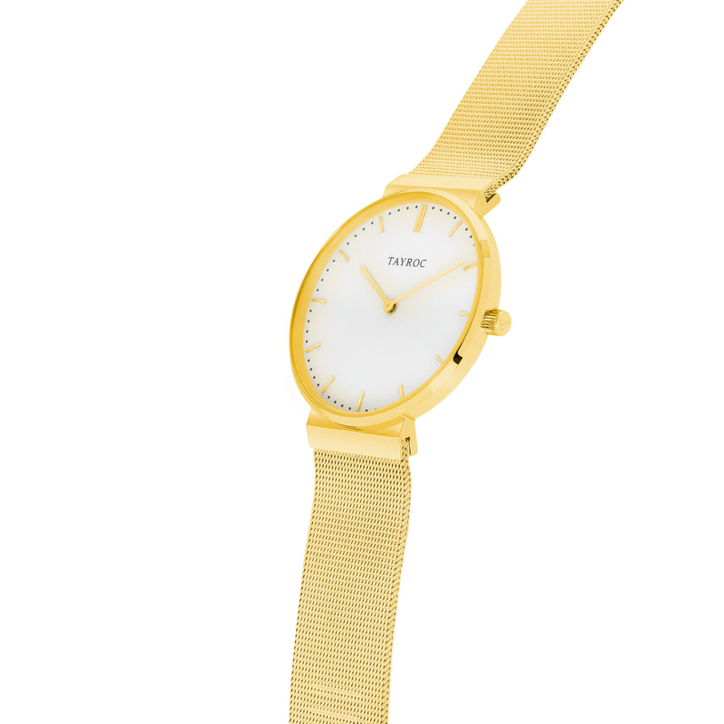 A polished white dial set into luxurious gold, Tal is an elegant gold womens watch for the fashion-forward. Side View.