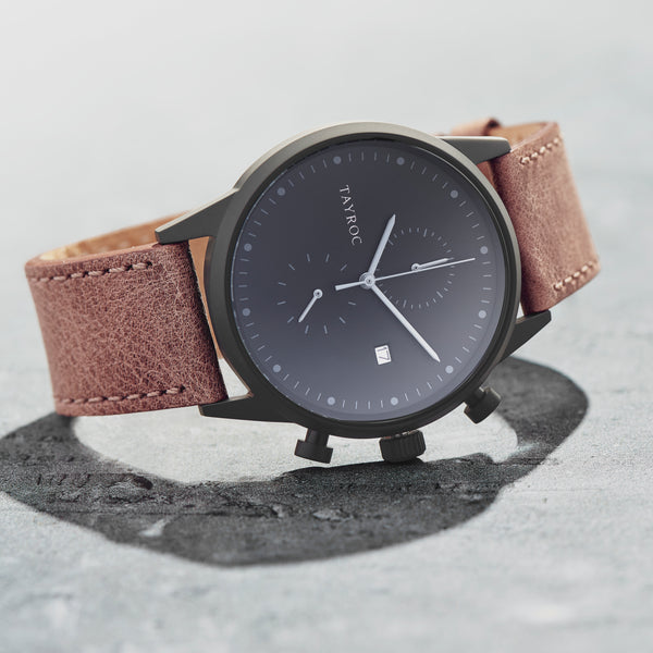 The dark palette of TXM123 combined with smooth leather strap and chronograph feature makes this timepiece an easy win with any outfit. Model view.