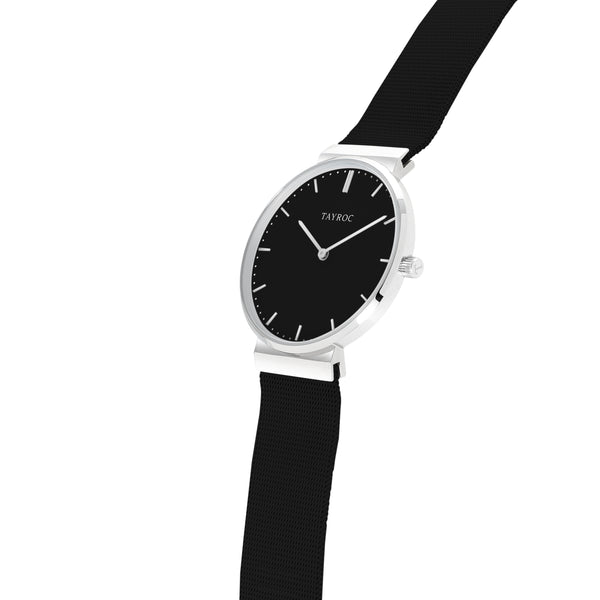 Striking, bold, simple. Thor is a black and silver watch in an analog style to give it both a strong style and easy functionality. Side view.