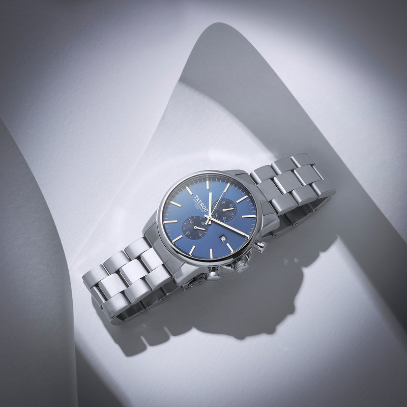 TXM119, a striking blue dial set into a silver case with silver two-tone bracelet. Model Shot 1.