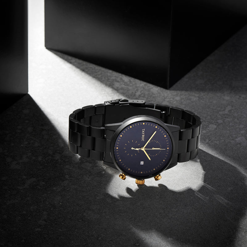 TXM126 is the killer design, a matte black watch punctuated with flashes of gold to create an eye catching finish. Model view.