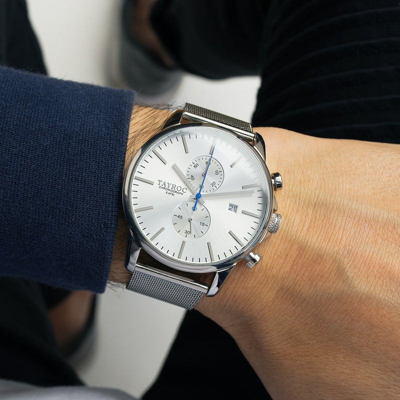 Stunning in fine silver with an eye catching blue streak. TXM052 is a sharp timepiece that makes an excellent addition to any outfit or collection. Model view.