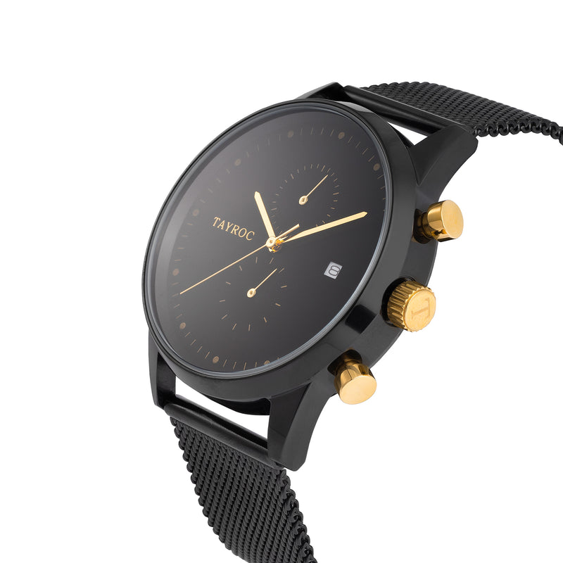 TXM087. Sleek black watch with gold accents and black mesh strap. Side view.