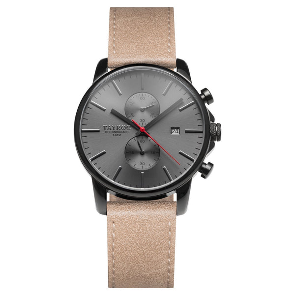 TXM093 from the Iconic Collection. A watch with black face and case, brought together with a leather strap.